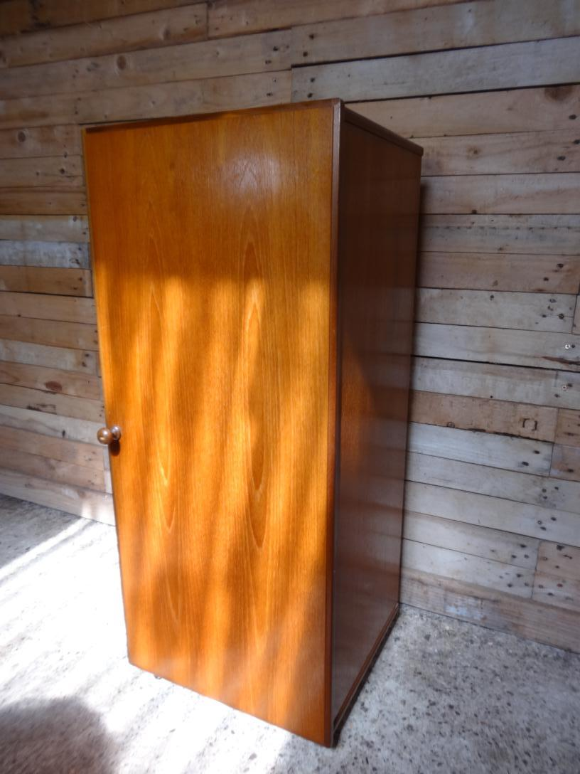 Tall teak hall cupboard